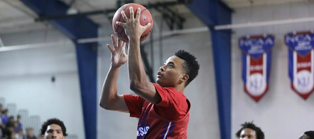 Red Team guard Devon Dotson soars in for a bucket during a scrimmage on Wednesday, June 13, 2018, at the Horejsi Family Athletics Center.