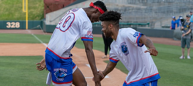 Frank Mason celebrates with Kings teammate Harry Giles during a charity softball game at Community America Ballpark Saturday. Mason coordinated the event, which included several former Jayhawks, to benefit the Children's Mercy Kansas City & National Youth Foundation.