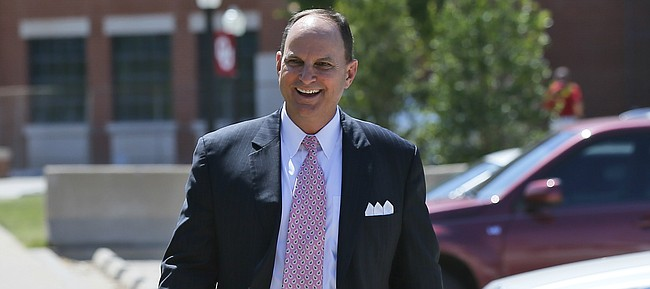 Oklahoma athletic director Joe Castiglione walks from the OU football stadium in Norman, Okla., after a news conference on Wednesday, June 7, 2017.