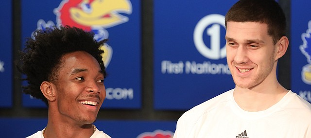 Kansas guards Devonte' Graham, left, and Sviatoslav Mykhailiuk (10) take questions about their seeding following the NCAA tournament selection show on Sunday, March 11, 2018 at Allen Fieldhouse. The Jayhawks will take on Penn in the first round, Thursday, in Wichita.