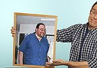 """In this photo illustration provided to the Journal-World in June 2018, John Ordover holds a framed photo of himself before he lost more than 100 pounds. Ordover chronicled his weight loss in his March 2018 book, """"Lie There and Lose Weight — How I Lost 100 Pounds By Doing Next to Nothing."""""""