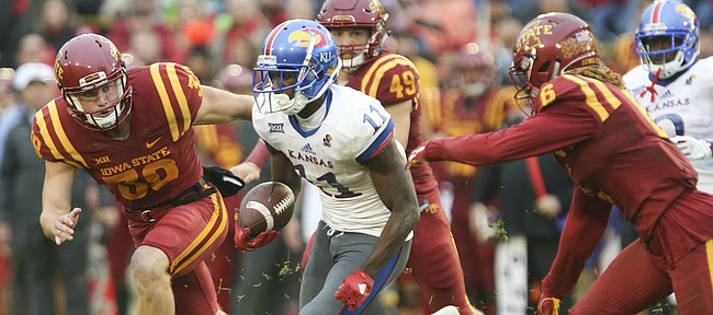 Kansas punt returner Steven Sims Jr. (11) is surrounded by several Iowa State players on a punt return during the fourth quarter on Saturday, Oct. 14, 2017 at Jack Trice Stadium in Ames, Iowa.