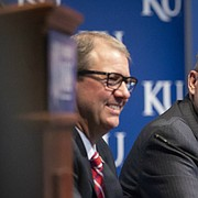 New University of Kansas athletic director Jeff Long addresses those gathered for his introductory news conference on Wednesday, July 11, 2018 at the Lied Center Pavilion. To his left is University of Kansas Chancellor Douglas Girod and at his right is former