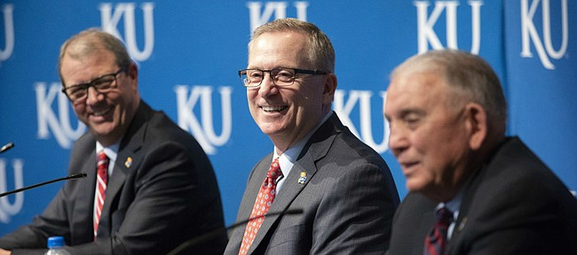 With University of Kansas chancellor Douglas Girod looking on, new KU athletic director Jeff Long smiles during an introductory news conference on Wednesday, July 11, 2018 at the Lied Center Pavilion.