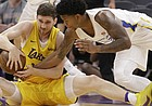 Los Angeles Lakers forward Sviatoslav Mykhailiuk, left, and Golden State Warriors guard Rion Brown battle for the ball during the first half of an NBA summer league basketball game Thursday, July 5, 2018, in Sacramento, Calif.