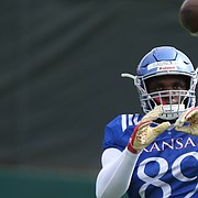 Kansas tight end Mavin Saunders catches a pass during practice on Tuesday, April 17, 2018.