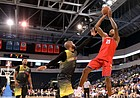 Kansas Alumni guard Brandon Rush pulls up for a shot over Missouri Alumni guard Julian Winfield during the second half of a charity scrimmage on Saturday, July 28, 2018 at Silverstein Eye Centers Arena in Independence, Mo.