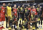 Members of the Kansas and Missouri Alumni teams come together for a picture during a break in the second half of a charity scrimmage on Saturday, July 28, 2018 at Silverstein Eye Centers Arena in Independence, Mo.