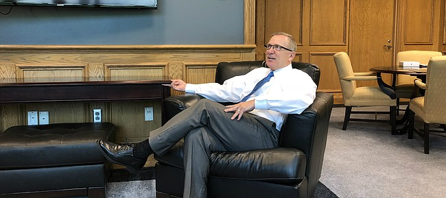 New Kansas athletic director Jeff Long, pictured here during his first day on the job on Aug. 1, 2018, hosted a small gathering with media members in his office to discuss, among other things, football, fund-raising and his adjustment to life in Lawrence.