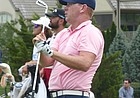 Chris Thompson watches his tee shot at No. 17 at Nicklaus Club at LionsGate come to a rest 2 feet in front of the cup, igniting big ovation from pro-KU crowd. Thompson birdied the final three holes Saturday and enters the final round of the KC Golf Classic in a tie for third. (Photo by Tom Keegan)
