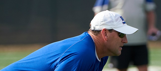 Kansas head coach David Beaty watches over players during a drill at practice on Saturday, August 4, 2018.