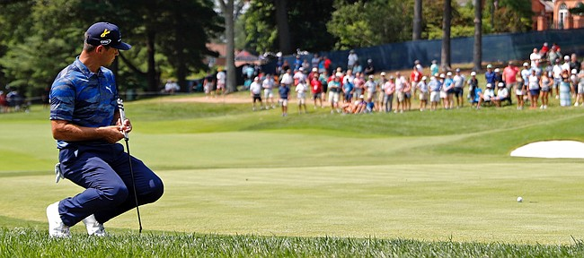 Gary Woodland reacts to a missed birdie putt on the fifth green during the third round of the PGA Championship golf tournament at Bellerive Country Club, Saturday, Aug. 11, 2018, in St. Louis. (AP Photo/Jeff Roberson)