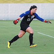 Kansas freshman goalkeeper Sarah Peters sends a kick toward the midfield in the first half. Kansas upset No. 18 Pepperdine 1-0 in its home opener