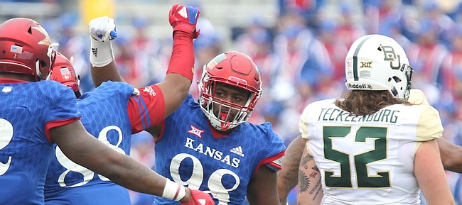Kansas defensive tackle KeyShaun Simmons (98) celebrates after stopping Baylor wide receiver Blake Lynch (21) in the backfield during the third quarter on Saturday, Sept. 4, 2017 at Memorial Stadium.