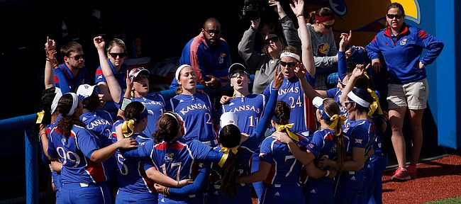 The Kansas softball team huddles together for the Alma Mater before taking on Idaho State at Arrocha Ballpark on March 14, 2015.