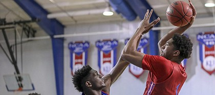 Red Team forward Dedric Lawson turns for a shot over Blue Team forward Silvio De Sousa during a scrimmage on Wednesday, June 13, 2018, at the Horejsi Family Athletics Center.