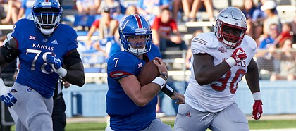 Kansas quarterback Peyton Bender (7) runs for the gain in the first quarter on Saturday, Sept. 1, 2018 at Memorial Stadium.
