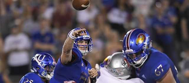 Kansas quarterback Peyton Bender (7) throws against Nicholls State during the second half of an NCAA college football game in Lawrence, Kan., Saturday, Sept. 1, 2018. (AP Photo/Reed Hoffmann
