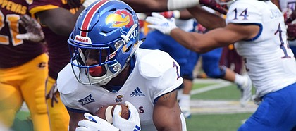 Kansas running back Pooka Williams Jr. carries the ball against Central Michigan during a game Saturday, Sept. 8, 2018, in Mount Pleasant, Mich. (Jim Lahde/The Morning Sun via AP)