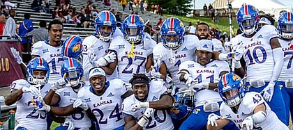 Members of the Kansas football team celebrate following the Jayhawks' 31-7 road win at Central Michigan, on Sept. 8, 2018, the program's first road win since 2009.