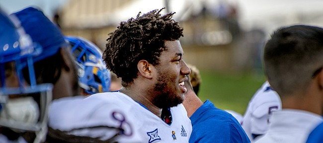 Kansas defensive tackle Daniel Wise smiles as he watches the closing moments of the Jayhawks' road win at Central Michigan.