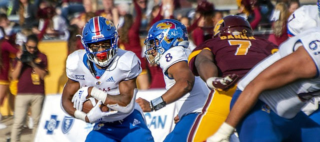 Kansas freshman running back Pooka Williams eyes a running lane against Central Michigan, during the Jayhawks' 31-7 road win Saturday at Kelly/Shorts Stadium in Mount Pleasant, Mich.