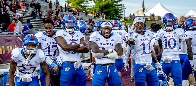 A contingent of Kansas football defensive players — from left, Elmore Hempstead Jr., Elijah Jones, Najee Stevens-McKenzie, Ricky Thomas, Mike Lee and Julian Chandler — pose on the sideline as the Jayhawks wrap up a road win at Central Michigan.