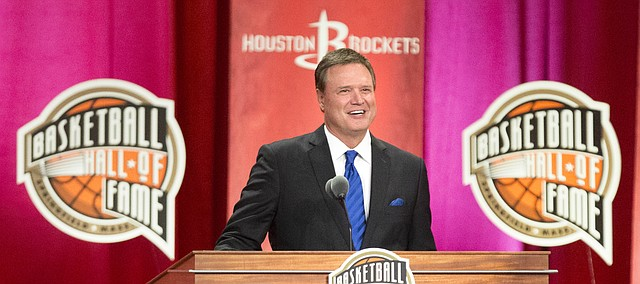 University of Kansas head basketball coach Bill Self smiles as he pays tribute to his players and staff members, past and present, during his inductions speech into the Naismith Memorial Basketball Hall of Fame on Friday, Sept. 8, 2017, at Symphony Hall in Springfield, Mass. At right is former Kansas and NBA head coach Larry Brown, who served as a mentor to Self.