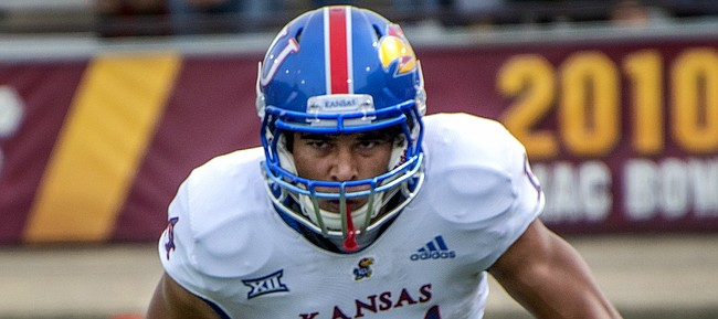 Kansas receiver Kerr Johnson Jr. surveys the field in front of him after making a reception at Central Michigan.
