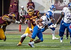 Kansas running back Pooka Williams looks for space in the open field during his college football debut, Sept. 8, 2018, at Central Michigan.