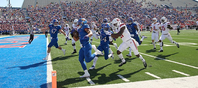 Kansas safety Bryce Torneden (1) runs in a touchdown after intercepting a Rutgers pass during the first quarter on Saturday, Sept. 15, 2018 at Memorial Stadium.