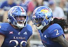 Kansas linebacker Joe Dineen Jr. (29) celebrates an interception by Kansas cornerback Corione Harris (2) during the third quarter on Saturday, Sept. 15, 2018 at Memorial Stadium.