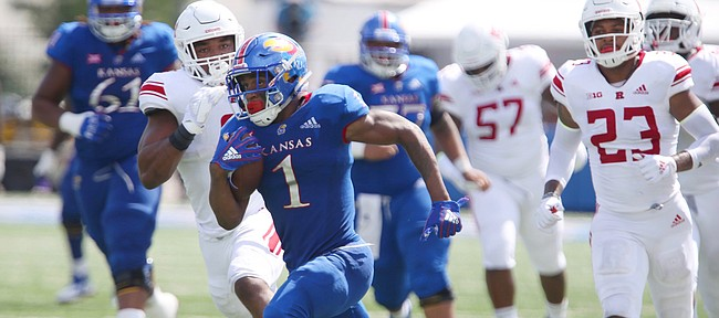 Kansas running back Pooka Williams Jr. (1) takes off on a touchdown run during the fourth quarter on Saturday, Sept. 15, 2018 at Memorial Stadium.