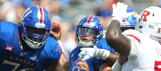 Kansas quarterback Miles Kendrick (8) throws behind his offensive line during the third quarter on Saturday, Sept. 15, 2018 at Memorial Stadium.