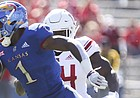 Kansas running back Pooka Williams Jr. (1) is finally dragged down by the Rutgers defense after a long run during the first quarter on Saturday, Sept. 15, 2018 at Memorial Stadium.