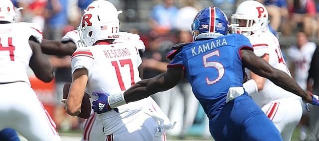 Kansas defensive end Azur Kamara (5) tries to get a hand on Rutgers quarterback Giovanni Rescigno (17) during the third quarter on Saturday, Sept. 15, 2018 at Memorial Stadium.