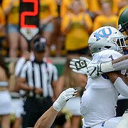 Baylor linebacker Clay Johnston (44) (bottom) and Baylor linebacker Jordan Williams (38) tackle Kansas running back Pooka Williams Jr. (1) during the first half of an NCAA college football game, Saturday, Sept. 22, 2018, in Waco, Texas.