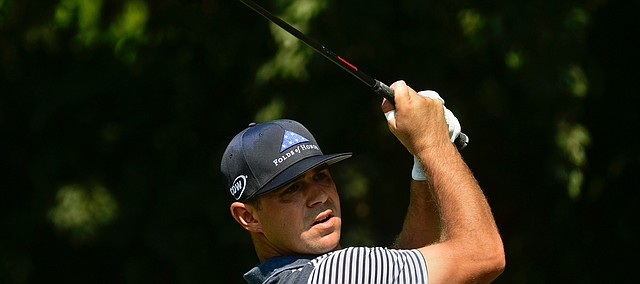 Gary Woodland hits from the second tee box during the first round of the Tour Championship golf tournament Thursday, Sept. 20, 2018, in Atlanta. (AP Photo/John Amis)
