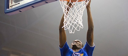 University of Kansas basketball senior Lagerald Vick grins while rising up for a slam during Late Night in the Phog, on Sept. 28, 2018, at Allen Fieldhouse.