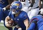 Kansas quarterback Carter Stanley is sacked by Oklahoma State on Saturday, Sept. 29, 2018.