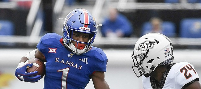 Kansas running back Pooka Williams Jr. jumps over a teammate to gain more yards against Oklahoma State on Saturday, Sept. 29, 2018.