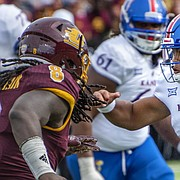 Kansas quarterback Miles Kendrick attempts to run through the Central Michigan defense on Saturday, Sept. 8, 2018 at Kelly/Shorts Stadium in Mount Pleasant, Mich.