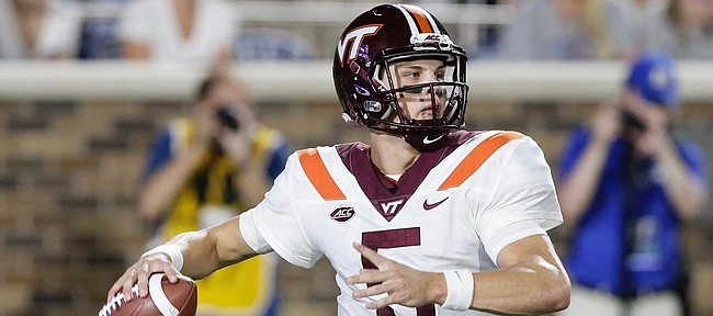Virginia Tech quarterback Ryan Willis (5) looks to pass against Duke during the first half of an NCAA college football game in Durham, N.C., Saturday, Sept. 29, 2018. (AP Photo/Gerry Broome)