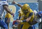 West Virginia quarterback Will Grier (7) fumbles the ball against Kansas during the second half of an NCAA college football game in Morgantown, W. Va., Saturday Oct. 6, 2018. (Craig Hudson/Charleston Gazette-Mail via AP)