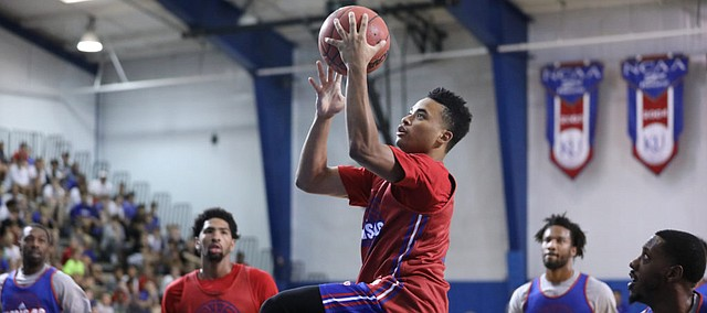 Red Team guard Devon Dotson soars in for a bucket during a scrimmage on Wednesday, June 13, 2018, at the Horejsi Family Athletics Center. (Nick Krug/Journal-World photo)