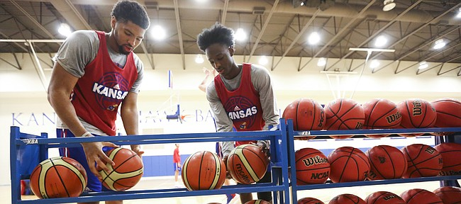 Kansas forward Dedric Lawson, left, and guard Marcus Garrett grab a couple of European basketballs during an open practice on Tuesday, July 11, 2017.