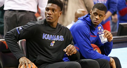 In this file photo from Dec. 29, 2017, Kansas forward Silvio DeSousa, left, sits next to teammate Billy Preston at Frank Erwin Center in Austin, Texas.