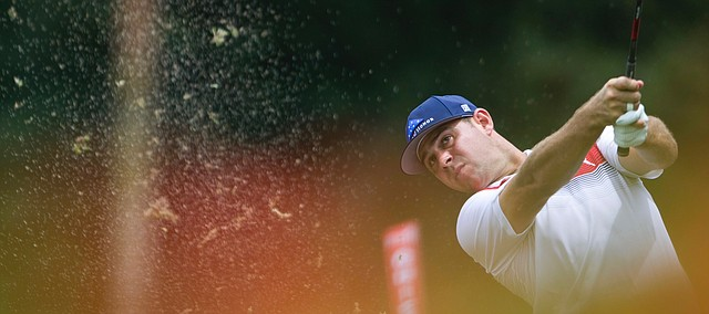 Gary Woodland of the United States of America plays a shot on the eighth hole during third round of the CIMB Classic golf tournament at Tournament Players Club (TPC) in Kuala Lumpur, Malaysia, Saturday, Oct. 13, 2018. (AP Photo/Yam G-Jun)