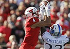 Texas Tech's Antoine Wesley (4) catches the pass over Kansas' Elmore Hempstead Jr. (23) during the first half of an NCAA college football game Saturday, Oct. 20, 2018, in Lubbock, Texas. (Brad Tollefson/Lubbock Avalanche-Journal via AP)