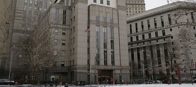 The Daniel Patrick Moynihan federal courthouse, center, is the site of the 2018 college basketball corruption trial in New York City. (AP Photo/Mark Lennihan)
